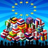 Siluetea la montaña de muchas cajas de los refugiados con una bandera de la UE Imágenes de archivo libres de regalías