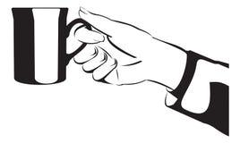 Siluetee la mano con la taza o la taza - ejemplo Fotos de archivo