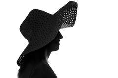 Siluetta in bianco e nero di una donna in un cappello Fotografia Stock Libera da Diritti