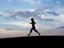 Siluetta che runing Fotografia Stock
