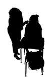 Siluetta con il percorso di residuo della potatura meccanica della donna e del bambino allo scrittorio Fotografia Stock Libera da Diritti