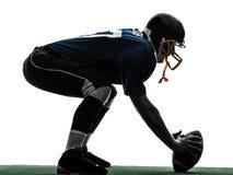 Siluetta concentrare dell'uomo del giocatore di football americano immagini stock