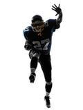 Siluetta corrente dell'uomo del giocatore di football americano fotografia stock libera da diritti