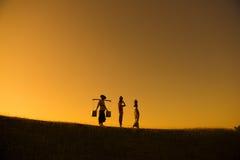 Siluetta degli agricoltori tradizionali asiatici del gruppo Fotografia Stock