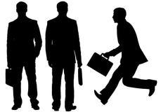 Siluetta degli uomini d'affari su fondo bianco Fotografia Stock Libera da Diritti
