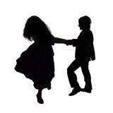 Siluetta dei bambini di dancing Partito dei bambini Fotografia Stock