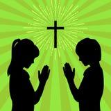 Siluetta dei bambini girati a Dio con la preghiera ed il culto illustrazione vettoriale