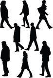 Siluetta dei camminatori Fotografie Stock