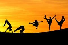 Siluetta dei gymnasts femminili Fotografia Stock Libera da Diritti