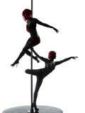 Siluetta del ballerino del palo di due donne Fotografie Stock Libere da Diritti