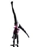 Siluetta del bambino della bambina di ginnastica ritmica Fotografia Stock