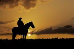 Siluetta del cowboy Fotografie Stock Libere da Diritti