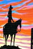 Siluetta del cowboy Immagini Stock