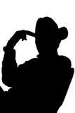 Siluetta del cowboy con il percorso di residuo della potatura meccanica Fotografia Stock