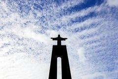Siluetta del Cristo-Rei o del re Christ Sanctuary in Almada Fotografia Stock Libera da Diritti