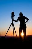 Siluetta del fotografo Immagine Stock