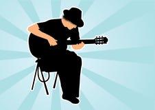 Siluetta del giocatore di chitarra Fotografia Stock