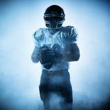 Siluetta del giocatore di football americano fotografie stock