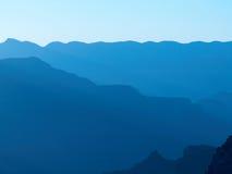 Siluetta del grande canyon - azzurro fotografie stock libere da diritti