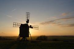 Siluetta del mulino a vento Fotografia Stock