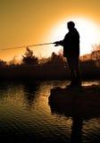 Siluetta del pescatore Immagini Stock Libere da Diritti