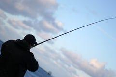 Siluetta del pescatore Immagini Stock