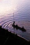 Siluetta del pescatore Fotografia Stock