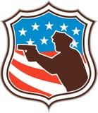 Siluetta del poliziotto che indica lo schermo della bandiera della pistola retro Fotografia Stock