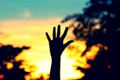 Siluetta del segno della mano con il fondo di tramonto Fotografia Stock Libera da Diritti