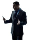 Siluetta del telefono dell'uomo di affari isolata Immagini Stock Libere da Diritti