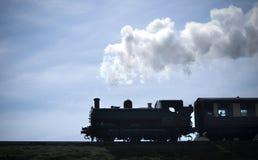 Siluetta del treno del vapore Fotografia Stock