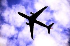 Siluetta dell'aria con le nuvole Fotografie Stock
