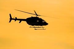 Siluetta dell'elicottero Fotografie Stock