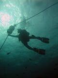 Siluetta dell'operatore subacqueo Fotografia Stock
