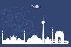 Siluetta dell'orizzonte della città di Delhi su fondo blu illustrazione di stock