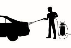 Siluetta dell'uomo che lava un'automobile Fotografie Stock