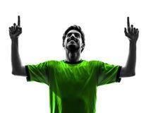 Siluetta dell'uomo di gioia di felicità del giocatore di football americano di calcio giovane immagini stock