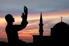 Siluetta dell'uomo musulmano Fotografie Stock