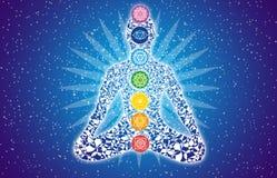 Siluetta dell'Yogi in una posa del loto contro un cielo stellato Fotografia Stock