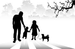 Siluetta della famiglia e del cane felici Immagine Stock Libera da Diritti