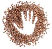 Siluetta della mano sui chicchi di caffè Fotografia Stock