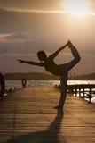 Siluetta della posizione di yoga Fotografia Stock