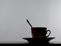 Siluetta della tazza di tè Fotografia Stock