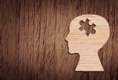 Siluetta della testa umana con un pezzo del puzzle tagliato immagini stock libere da diritti