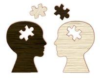 Siluetta della testa umana con un puzzle tagliata immagini stock libere da diritti