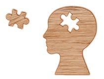 Siluetta della testa umana con un puzzle tagliata fotografia stock