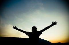 Siluetta delle braccia Outstretched Fotografie Stock