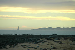 Siluetta delle dune di sabbia e del faro Immagini Stock Libere da Diritti