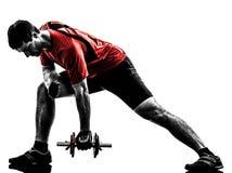Siluetta di addestramento del peso di esercitazione dell'uomo Fotografie Stock