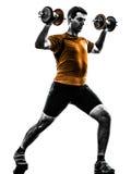 Siluetta di addestramento del peso di esercitazione dell'uomo Fotografia Stock